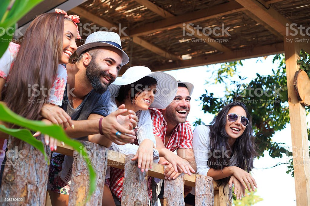 Group young people having fun on porch stock photo