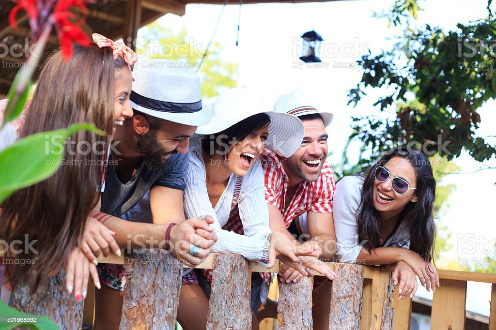 Group young people laughing on porch stock photo