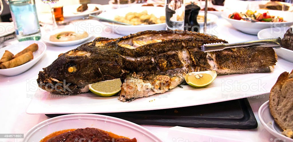 Grouper baked in the oven at the banquet table stock photo