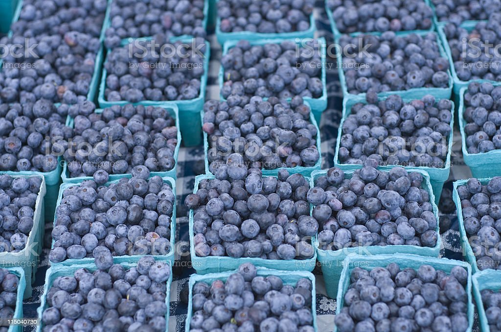 Groups of Blueberries in Multiple Small Baskets on a Table stock photo