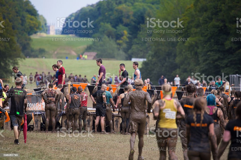 Groups of 'Mudders' running in Cirencester Park stock photo