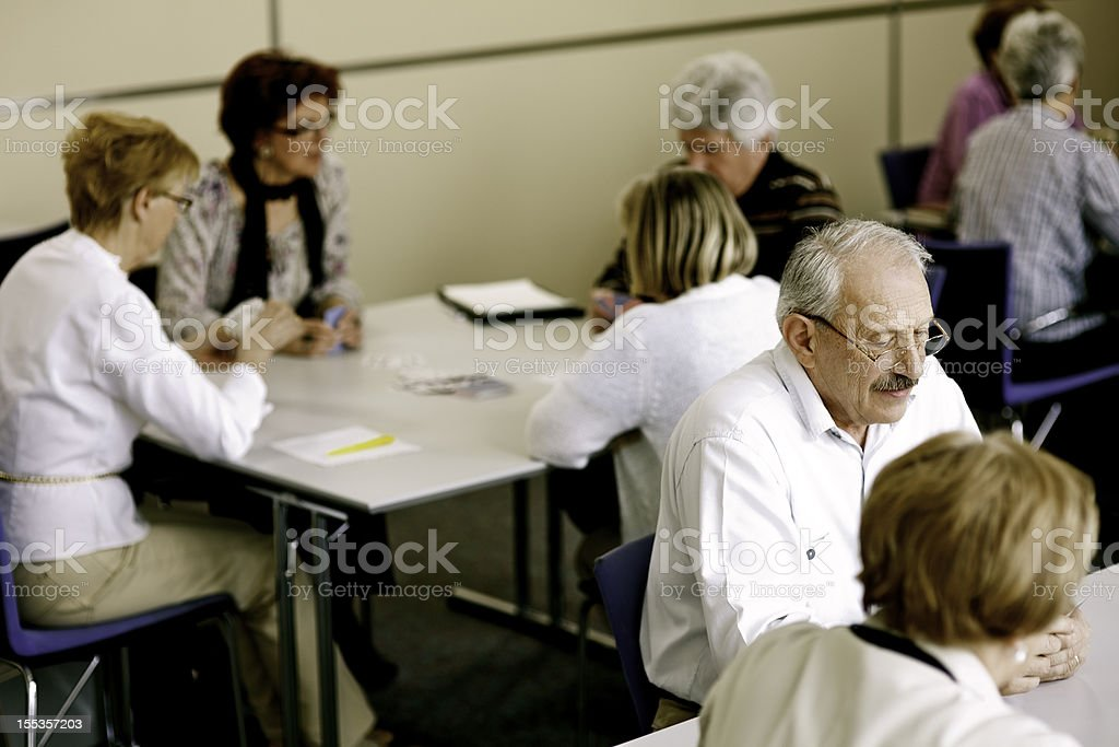 Groups of Seniors Playing Cards stock photo