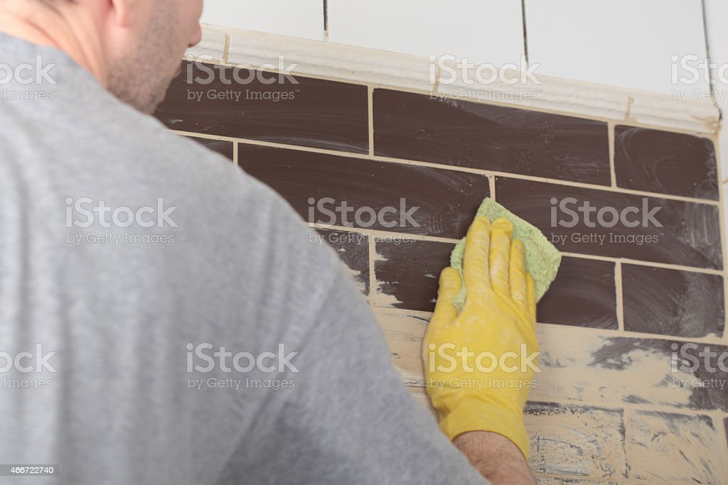 Grouting ceramic tiles stock photo