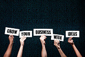 'Grow your Business with Ideas' say hand-held signs