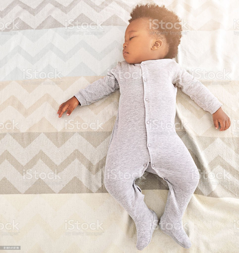 Growing babies need plenty of sleep stock photo
