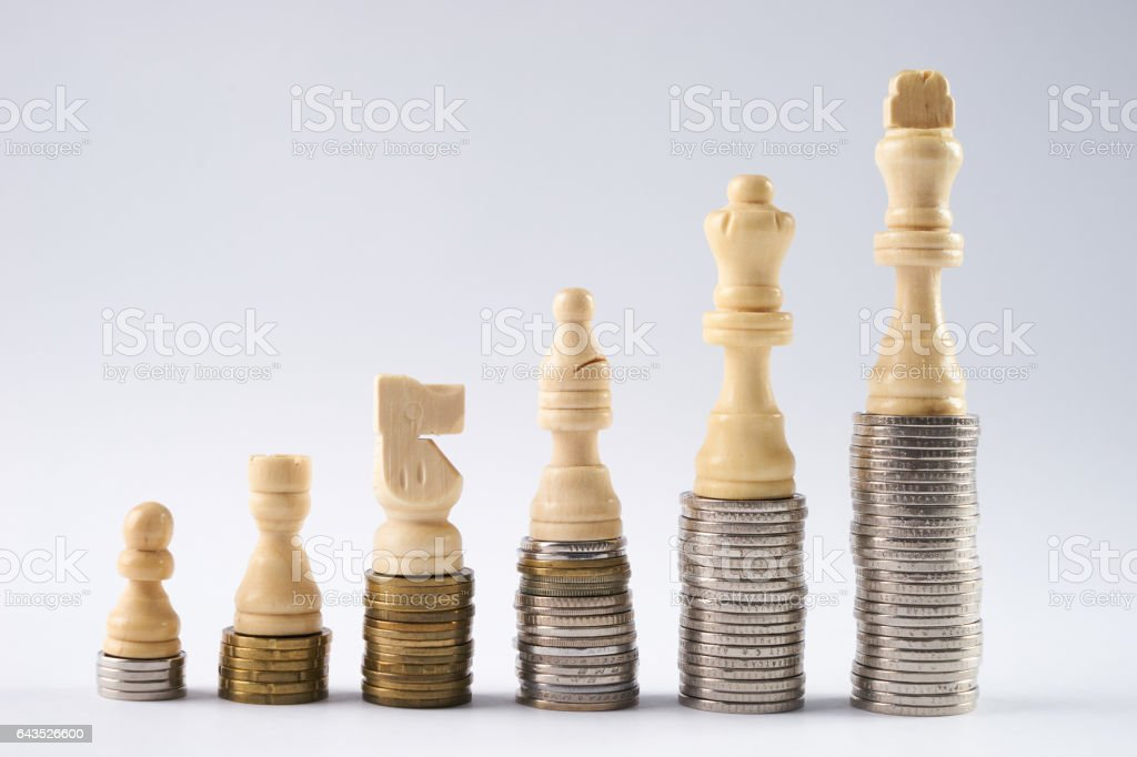 Growing coins stacks on white background stock photo