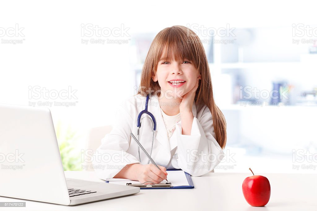 Growing up to be a doctor stock photo