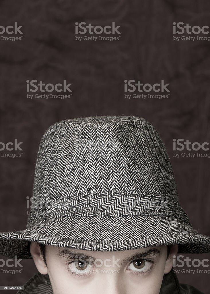 Growing up with a hat stock photo