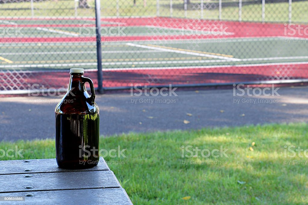 Growler in Front of Tennis Courts stock photo