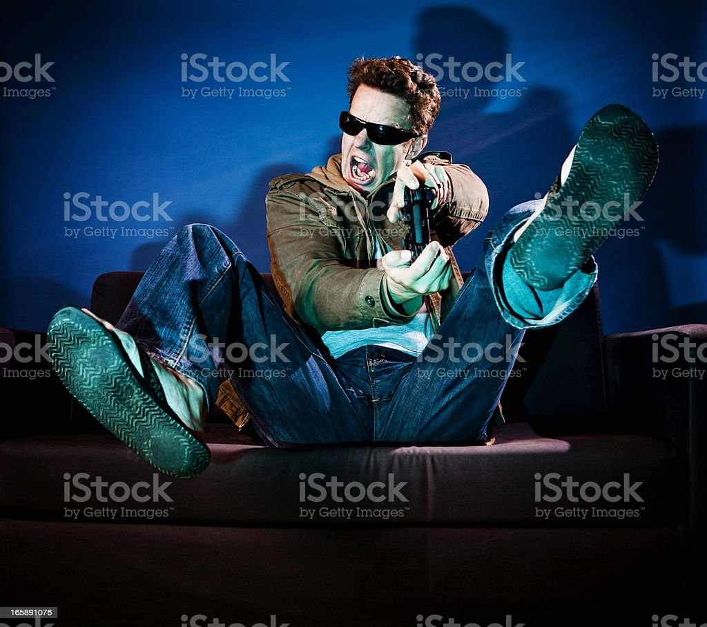 Grown Man in 40s Playing Video Games royalty-free stock photo