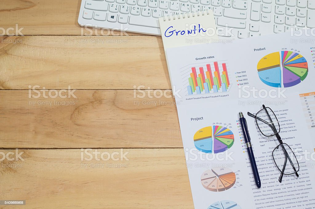 growth rate sale analysis report,with blank space wooden background Стоковые фото Стоковая фотография