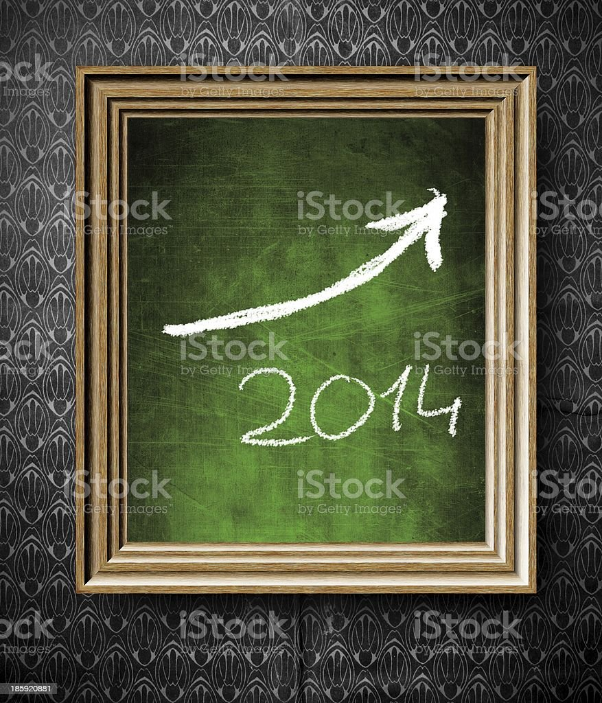 Growth trend of 2014 with copy-space chalkboard in frame stock photo