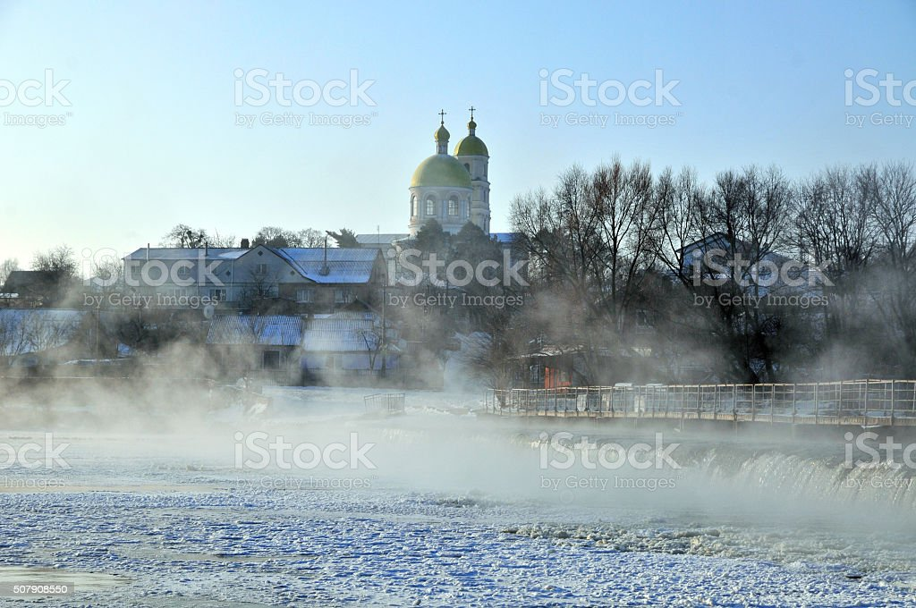 Groyne hydraulic structure of on the river Ros. Orthodox Church. stock photo