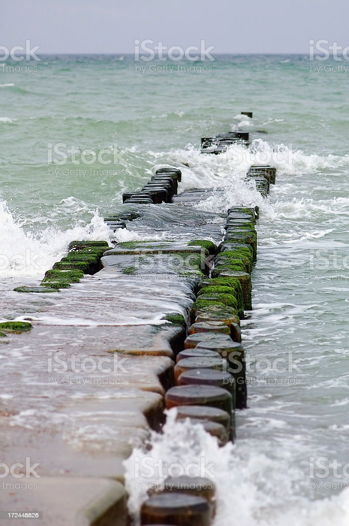 groyne with waves Baltic Sea beach of Darss peninsulas (Germany) royalty-free stock photo