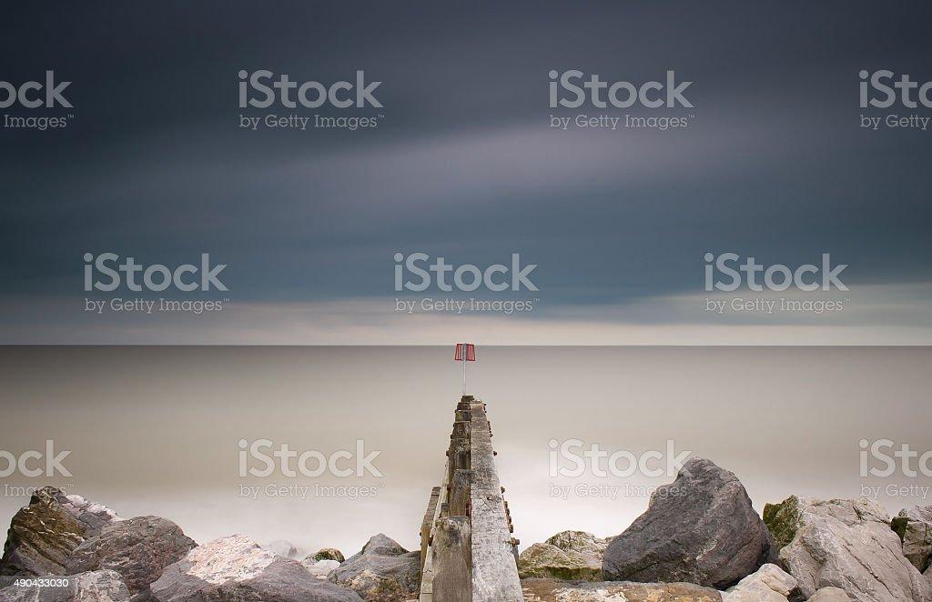 Groynes and rock armour, Aldeburgh, Suffolk stock photo