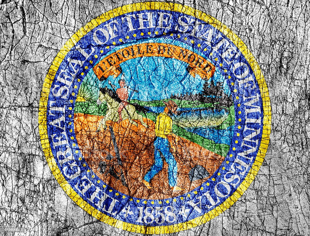 Grudge stone painted US Minnesota seal flag stock photo
