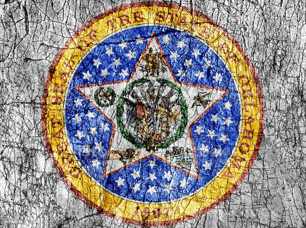 Grudge stone painted US Oklahoma seal flag stock photo