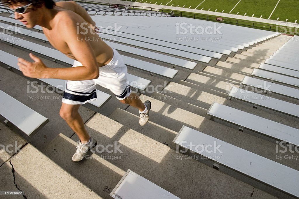 Grueling workout on stadium stairs royalty-free stock photo