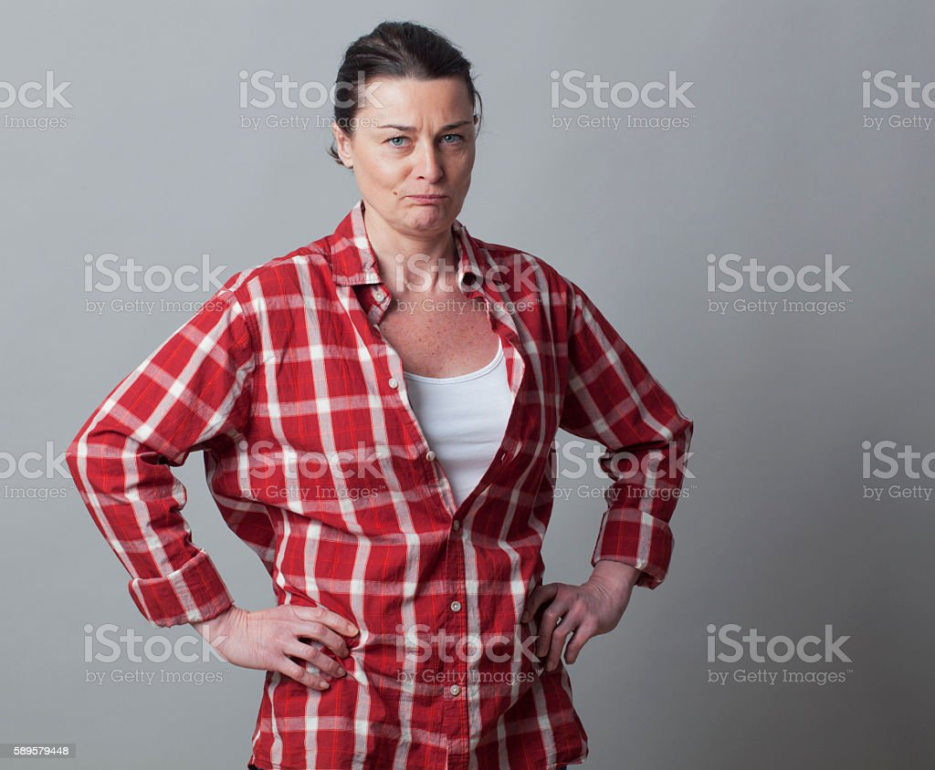 grumpy beautiful mature woman standing for gender independence stock photo