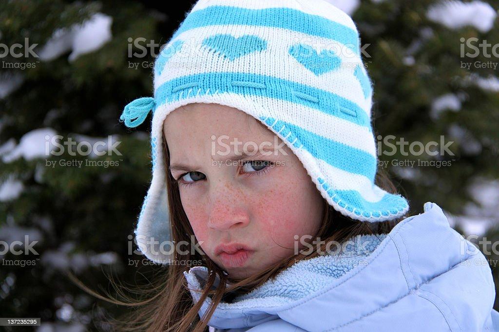Grumpy girl in winter stock photo