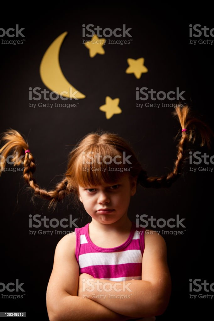 Grumpy Girl with Upward Braids Standing Under Moon and Stars royalty-free stock photo