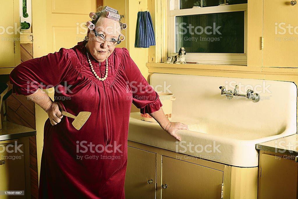 Grumpy Granny in Kitchen royalty-free stock photo