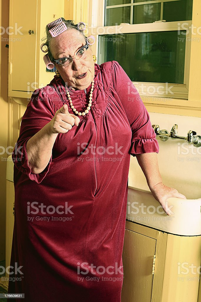 Grumpy Granny in Kitchen stock photo