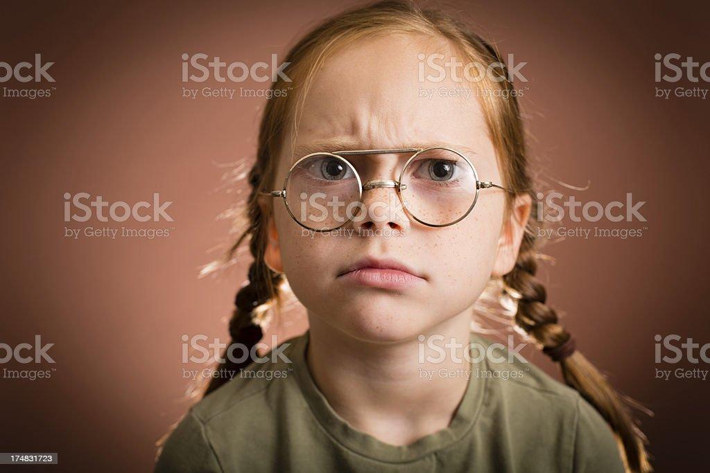 Grumpy Little Girl Wearing Vintage, Nerdy Glasses royalty-free stock photo