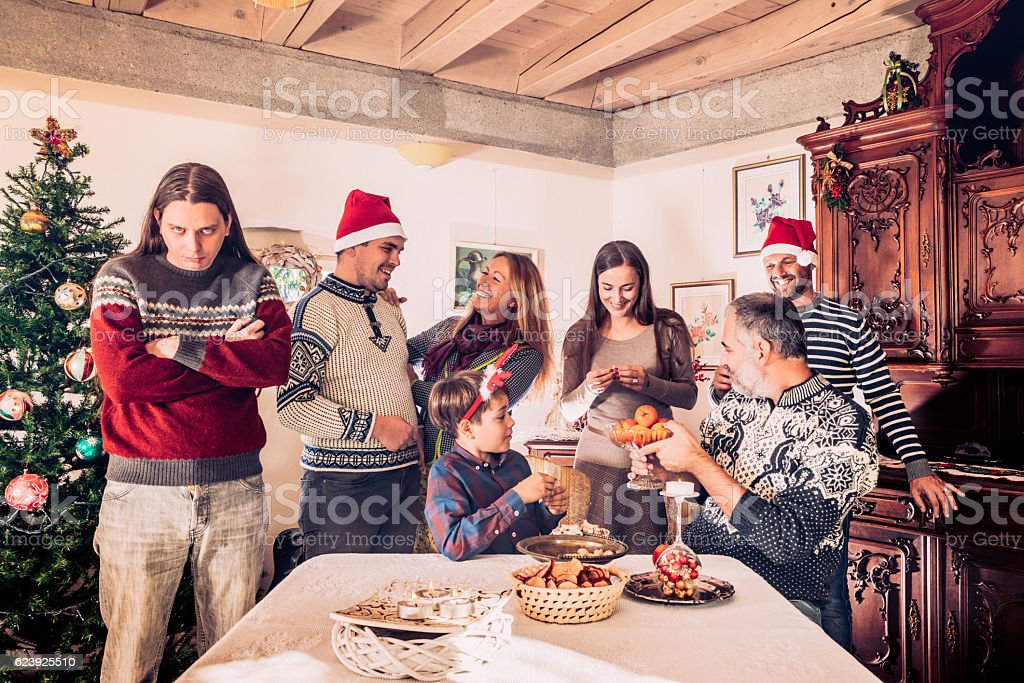 Grumpy Man on Christmas Family reunion stock photo