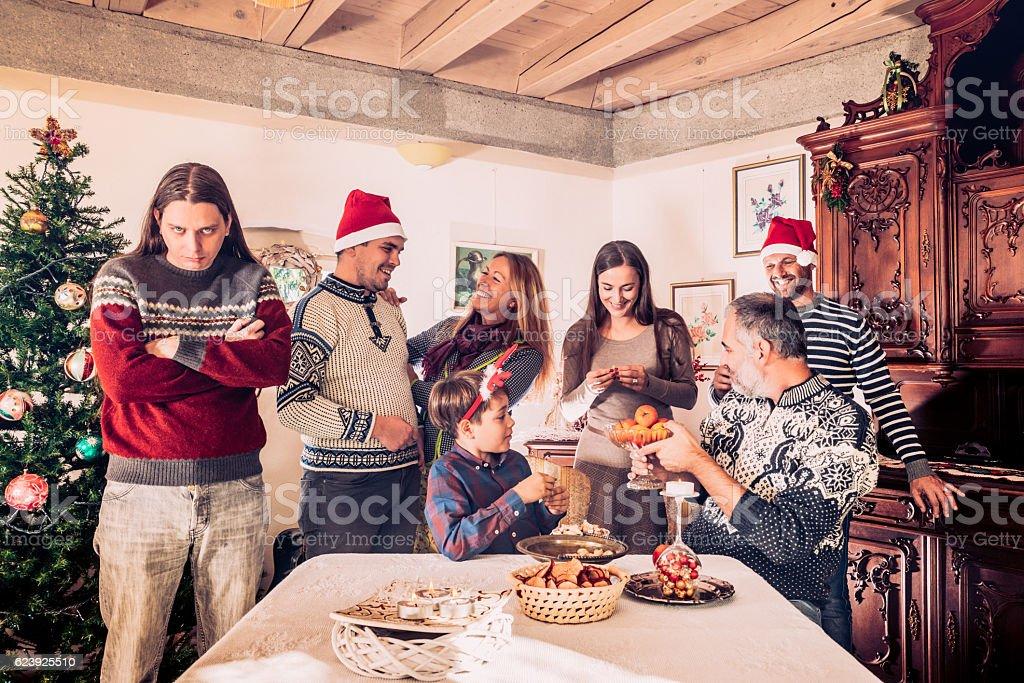 Grumpy Man on Christmas Family reunion stock photo