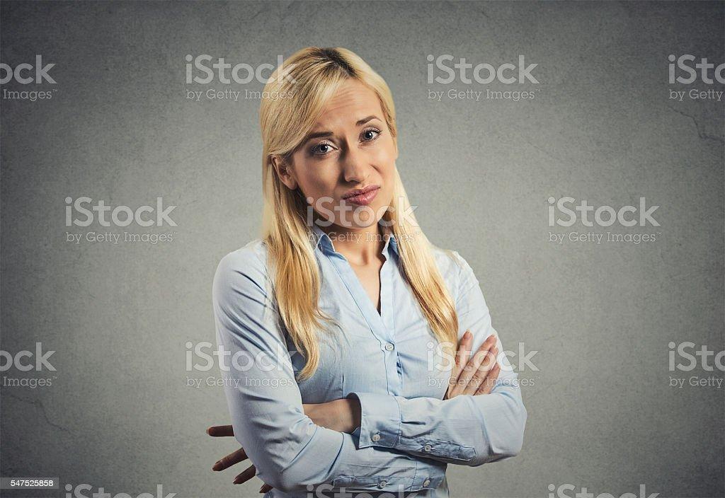 grumpy skeptical blonde woman stock photo