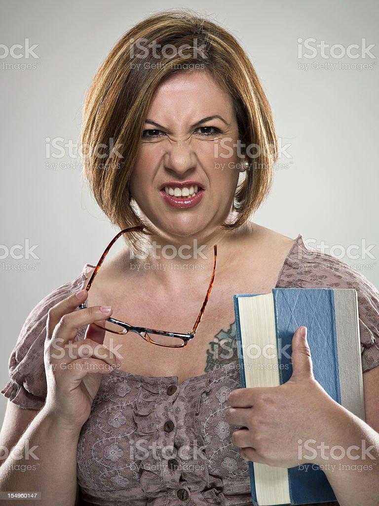 Grumpy teacher (real people) royalty-free stock photo