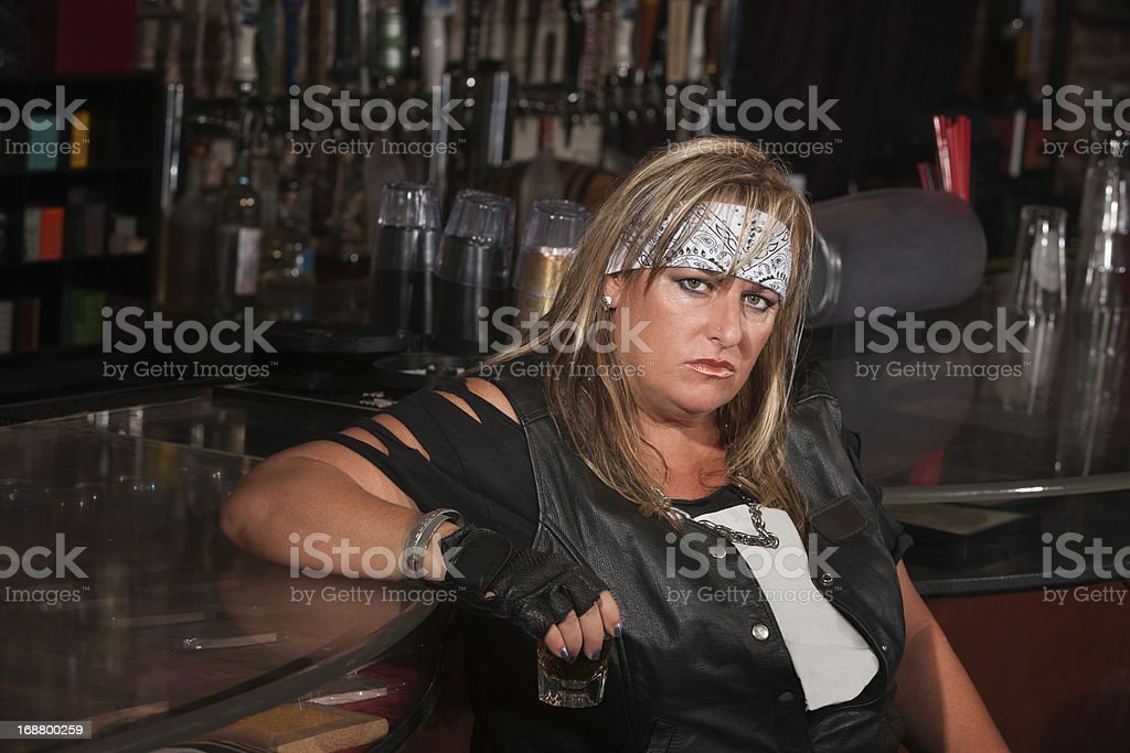 Grumpy Woman Holding Drink Glass royalty-free stock photo