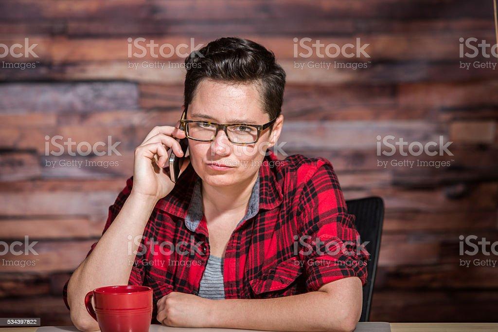 Grumpy Woman on Phone stock photo