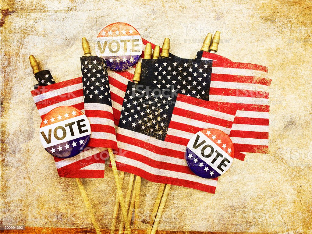 Grunge American flags and VOTE campaign buttons stock photo