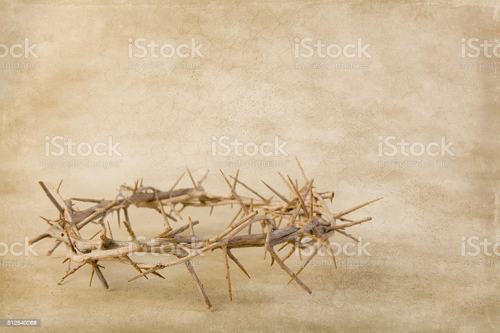 Grunge backdrop with crown of thorns stock photo
