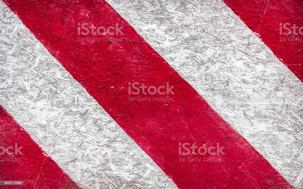 Grunge background of red and white stripes stock photo