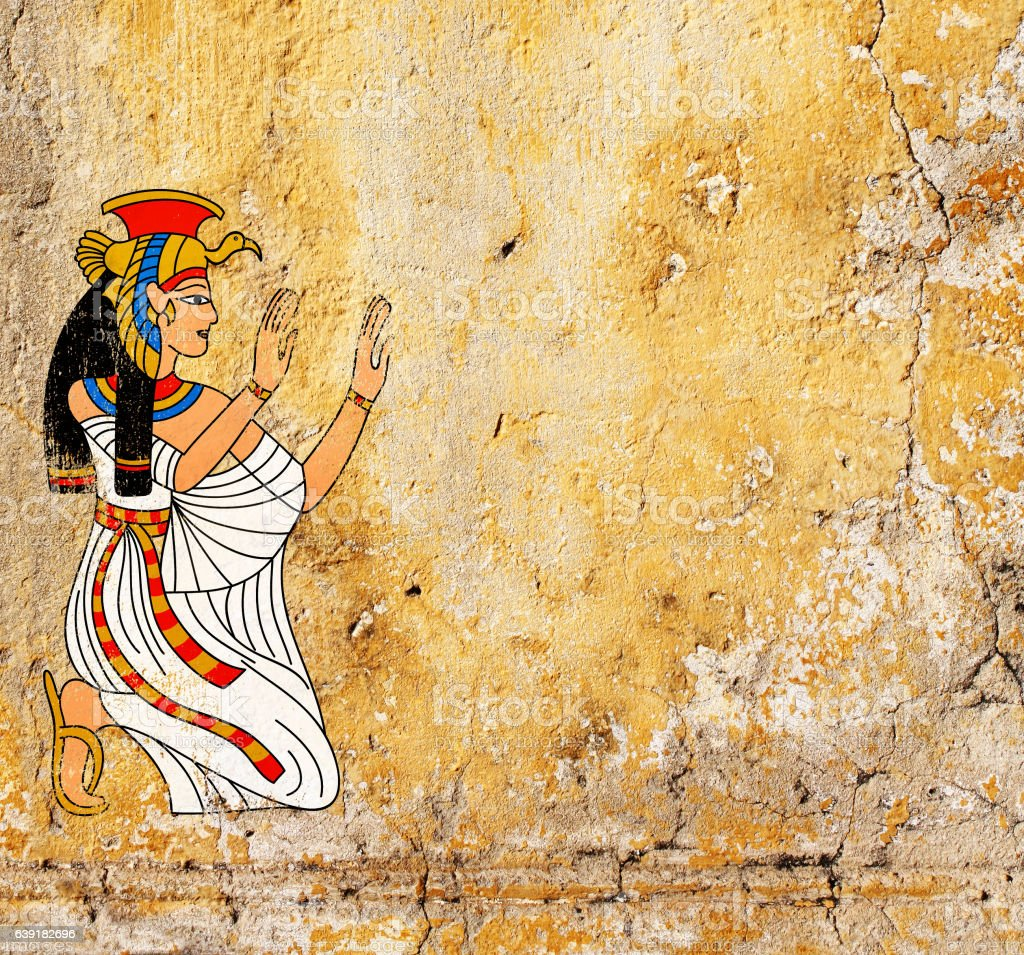 Grunge background with old stucco texture and Egyptian goddess I stock photo