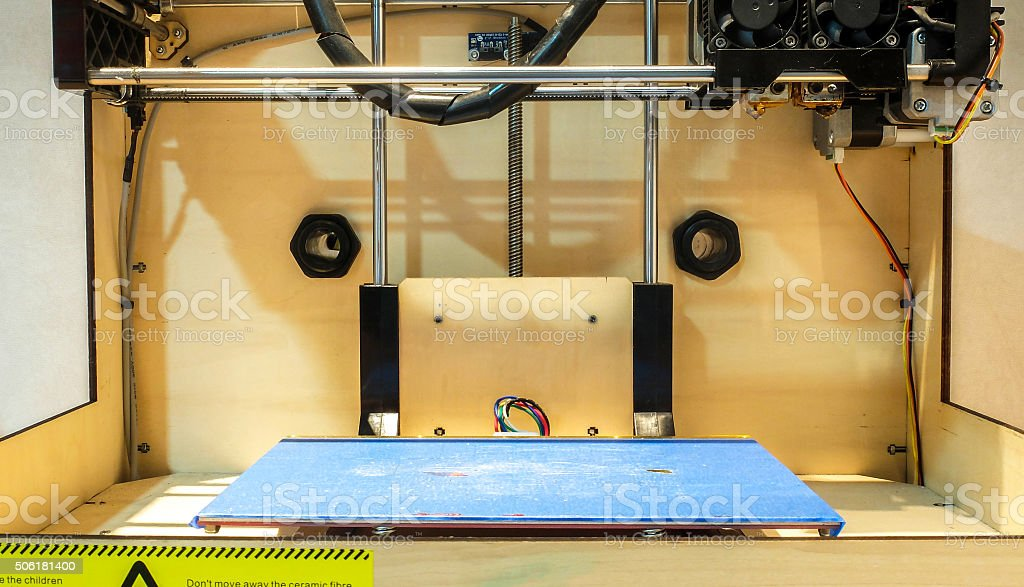 Grunge Blue Plate in Classic Wooden 3D Printer stock photo