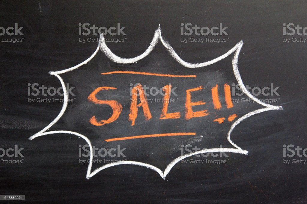 Grunge bubble draw by white chalk with sale wording on black board background stock photo