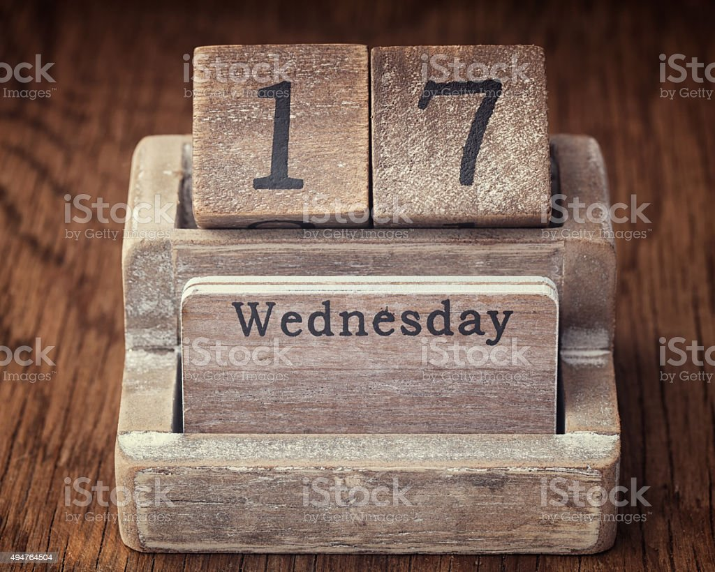 Grunge calendar showing Wednesday the seventieth  on wood backgr stock photo