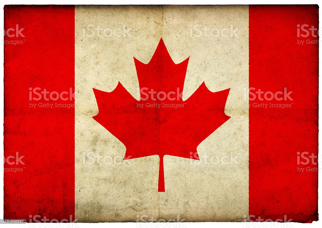 Grunge Canadian Flag on rough edged old postcard stock photo