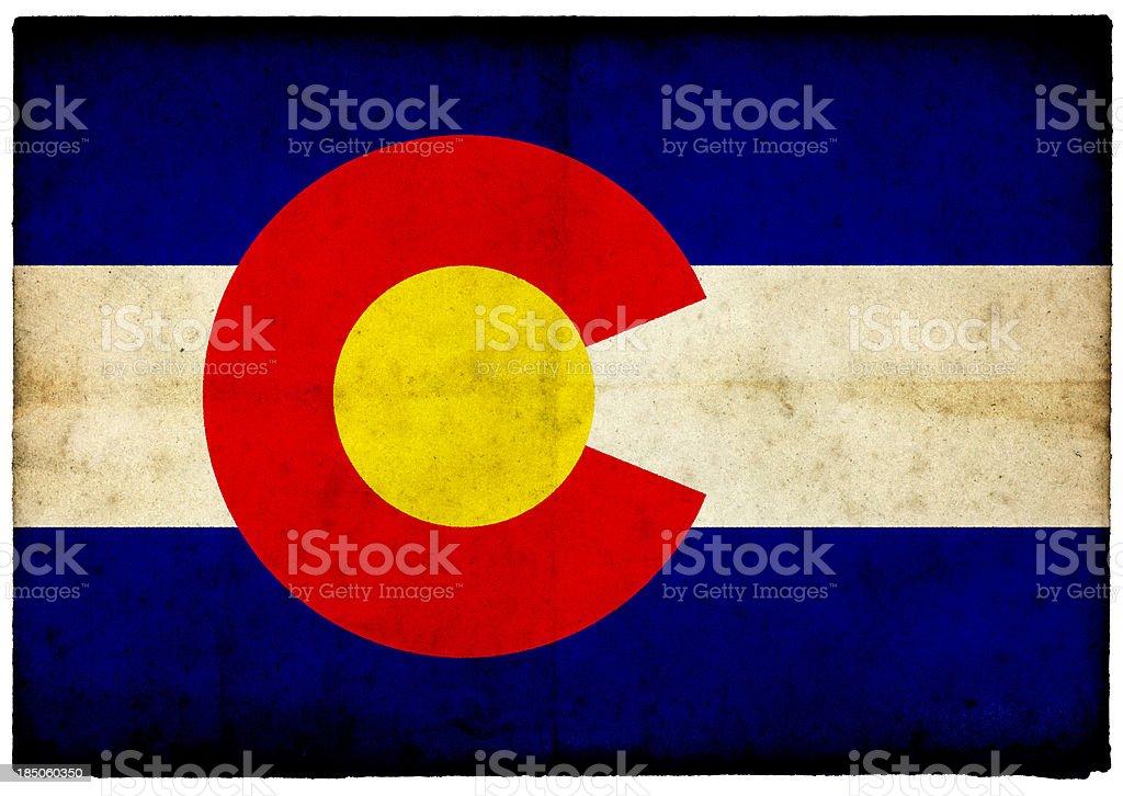 Grunge Colorado Flag on rough edged old postcard stock photo