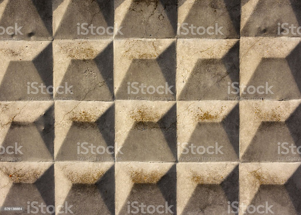Grunge cracked concrete slab with rhombus texture. stock photo