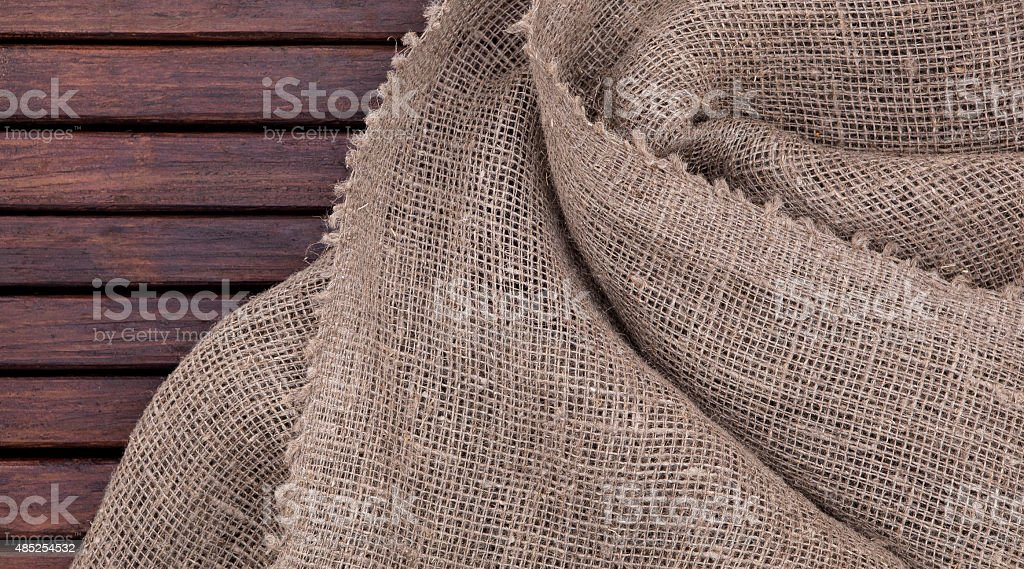 Grunge dark wood texture and textile texture. burlap stock photo