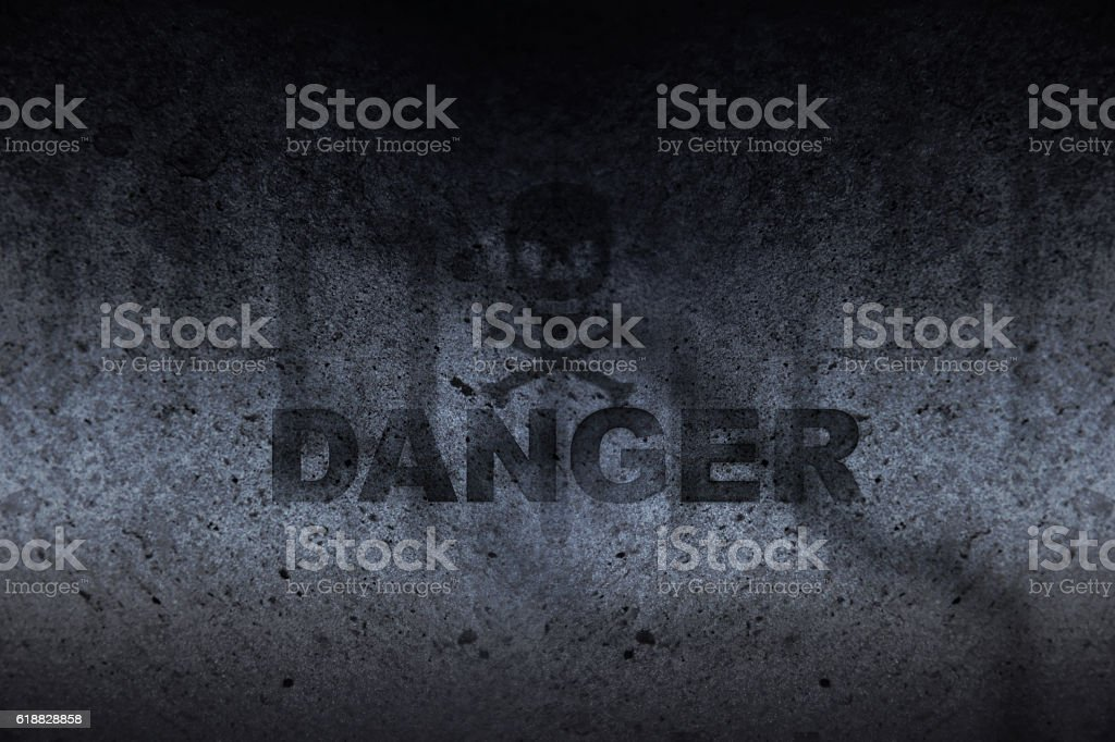 Grunge, Darkness Wall, Skull and crossbones with word: Danger stock photo