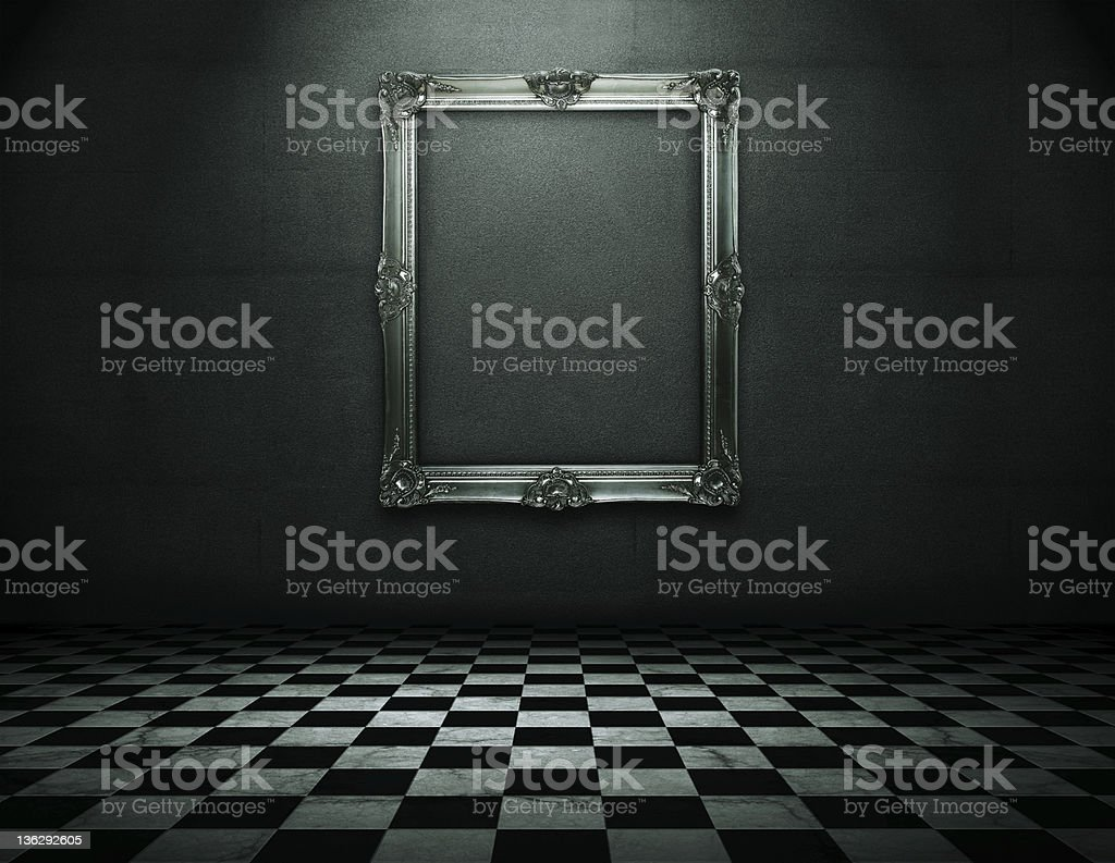 Grunge empty interior with frame on the wall stock photo