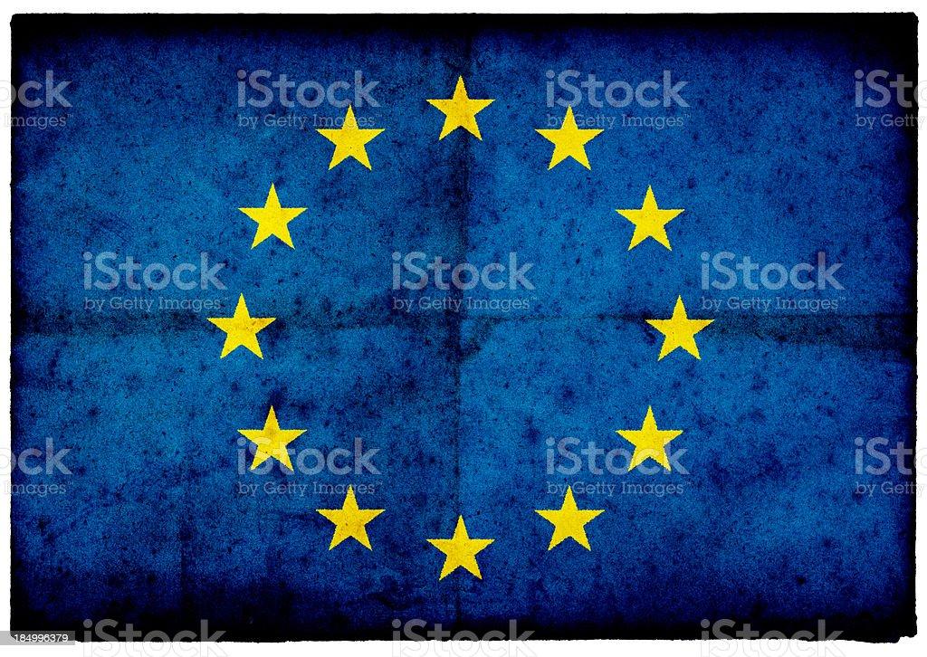 Grunge European Union Flag on rough edged old postcard royalty-free stock photo