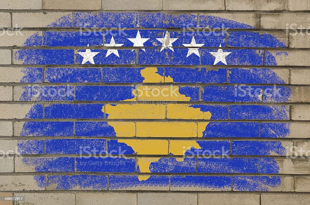grunge flag of kosovo on brick wall painted with chalk stock photo