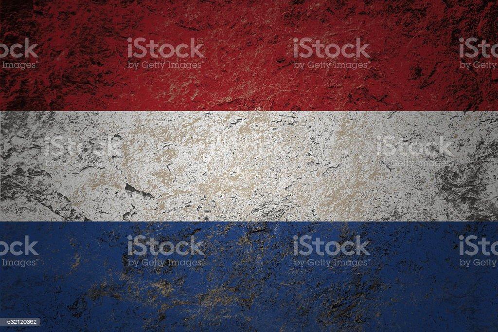 grunge flag of Netherland on stone background stock photo